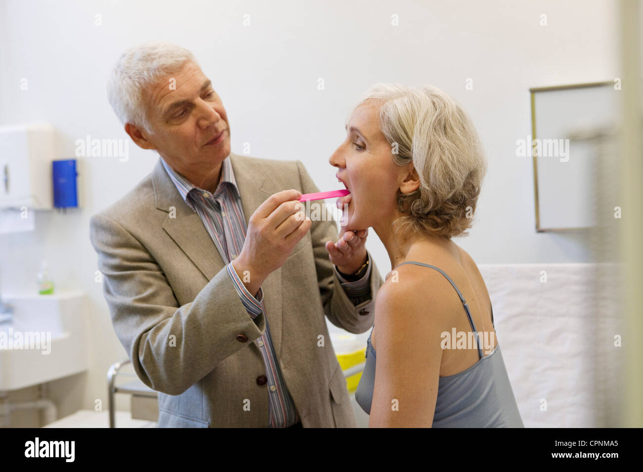 EAR NOSE &THROAT, ELDERLY PERSON - Stock Image