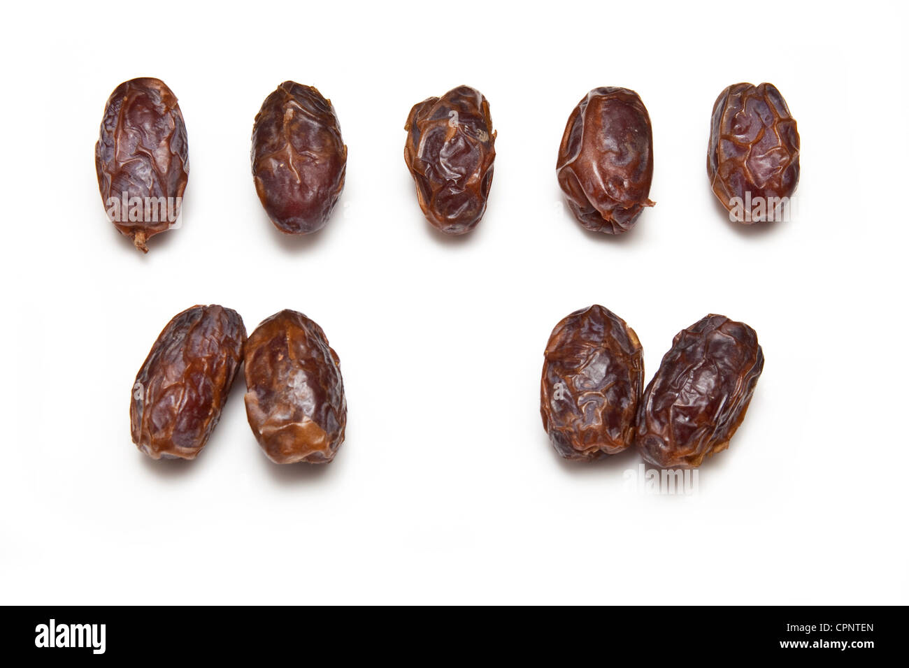 Dried Medjool dates isolated on a white studio background. - Stock Image