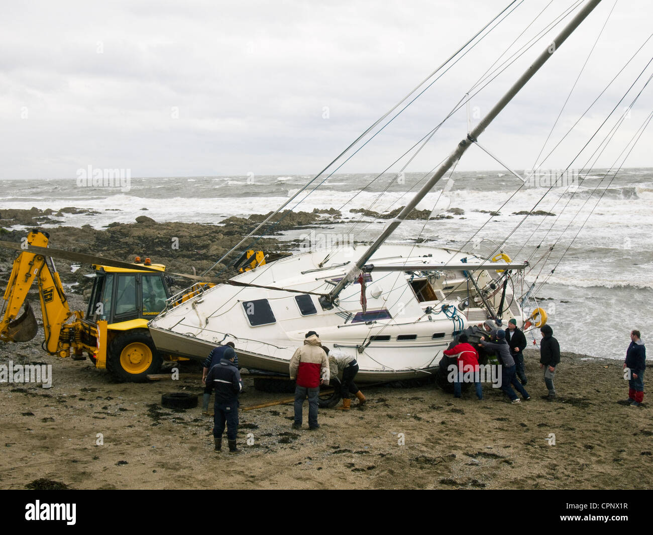 Yachts thrown up on the rocks at Skerries, county Dublin, Ireland after a spring storm in 2012 - Stock Image