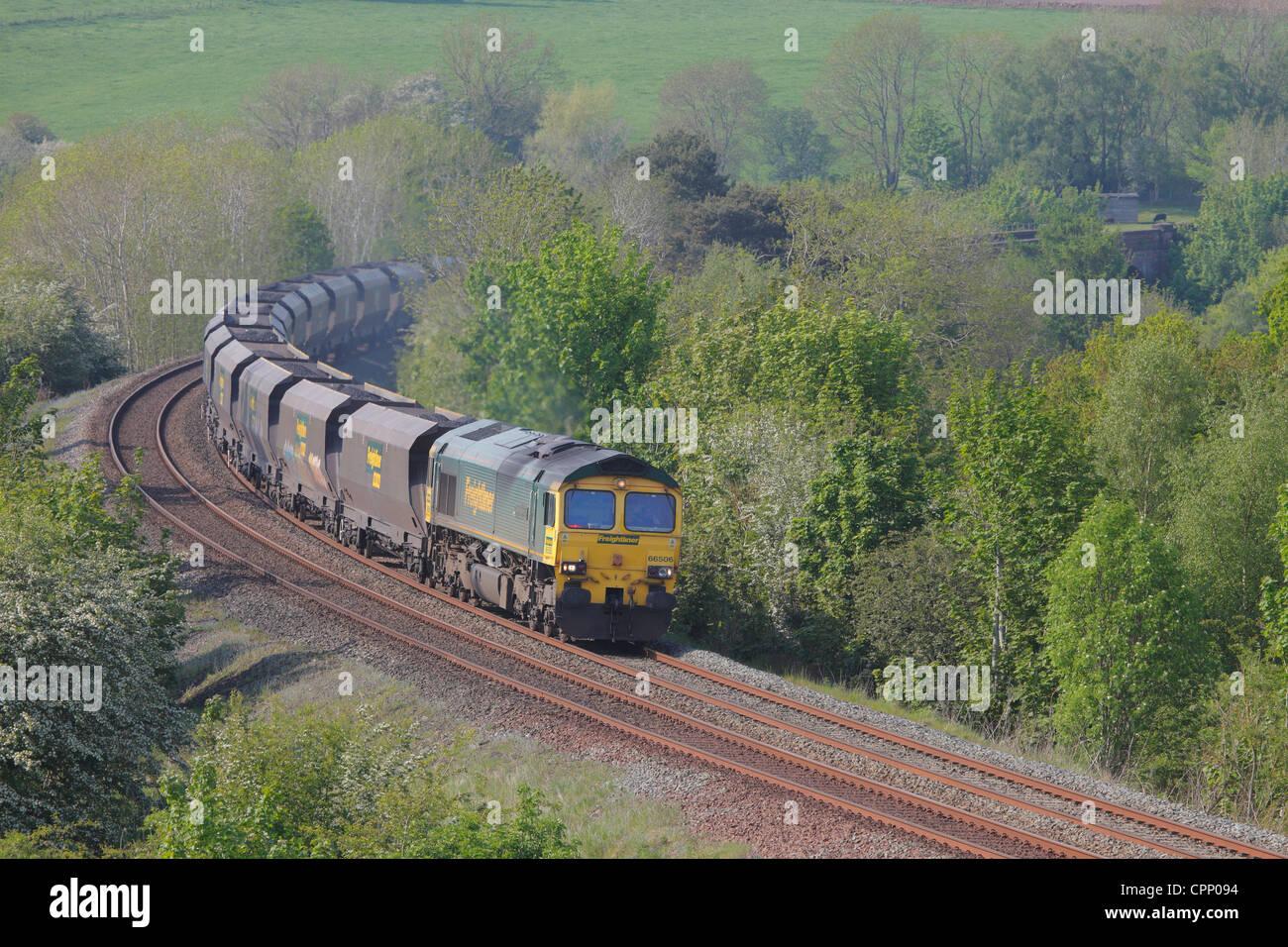 Freightliner 66506 mainline diesel locomotive train near Low Baron Wood Farm Armathwaite Eden Valley, Cumbria, England, - Stock Image
