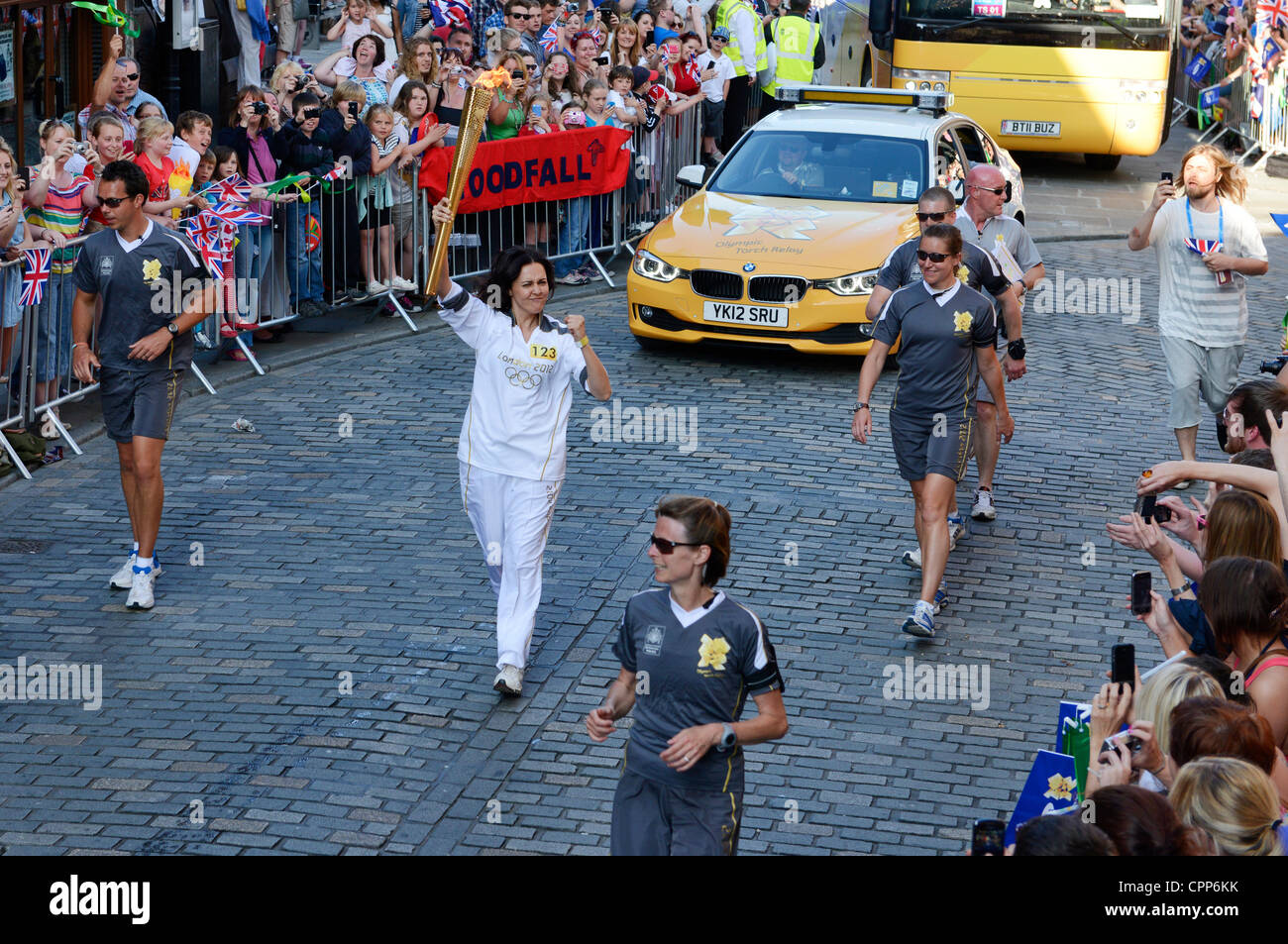 Chester, UK. 29 May, 2012. The Olympic Torch makes it's way through the streets of Chester passing The Cross - Stock Image