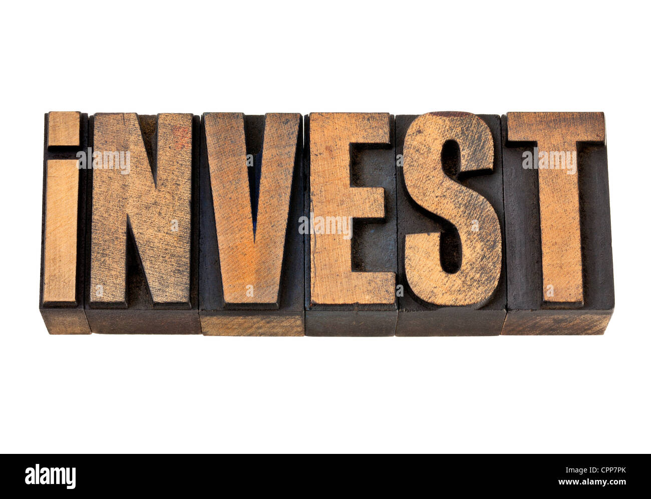 invest - isolated word in vintage letterpress wood type - Stock Image