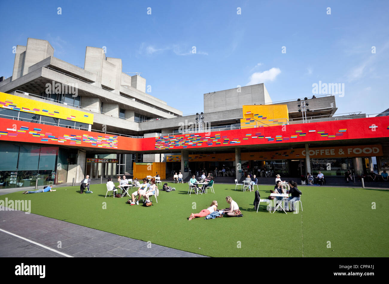 People enjoying summer on the artificial lawn outside The National Theatre, Southbank, London, England, UK - Stock Image