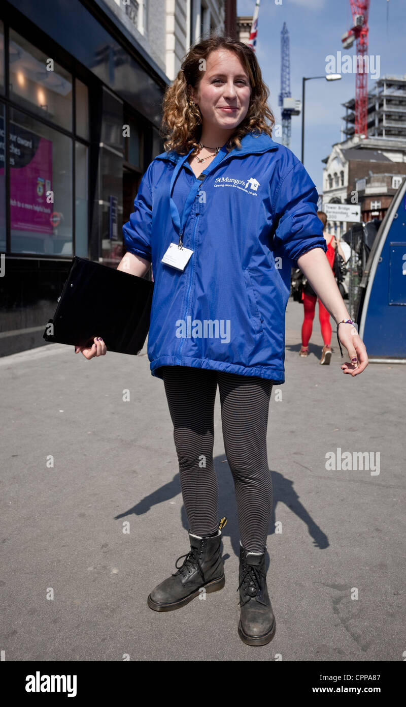 Full length portrait of a St Mungo's (opening doors for homeless people) charity street collector, London Bridge, - Stock Image