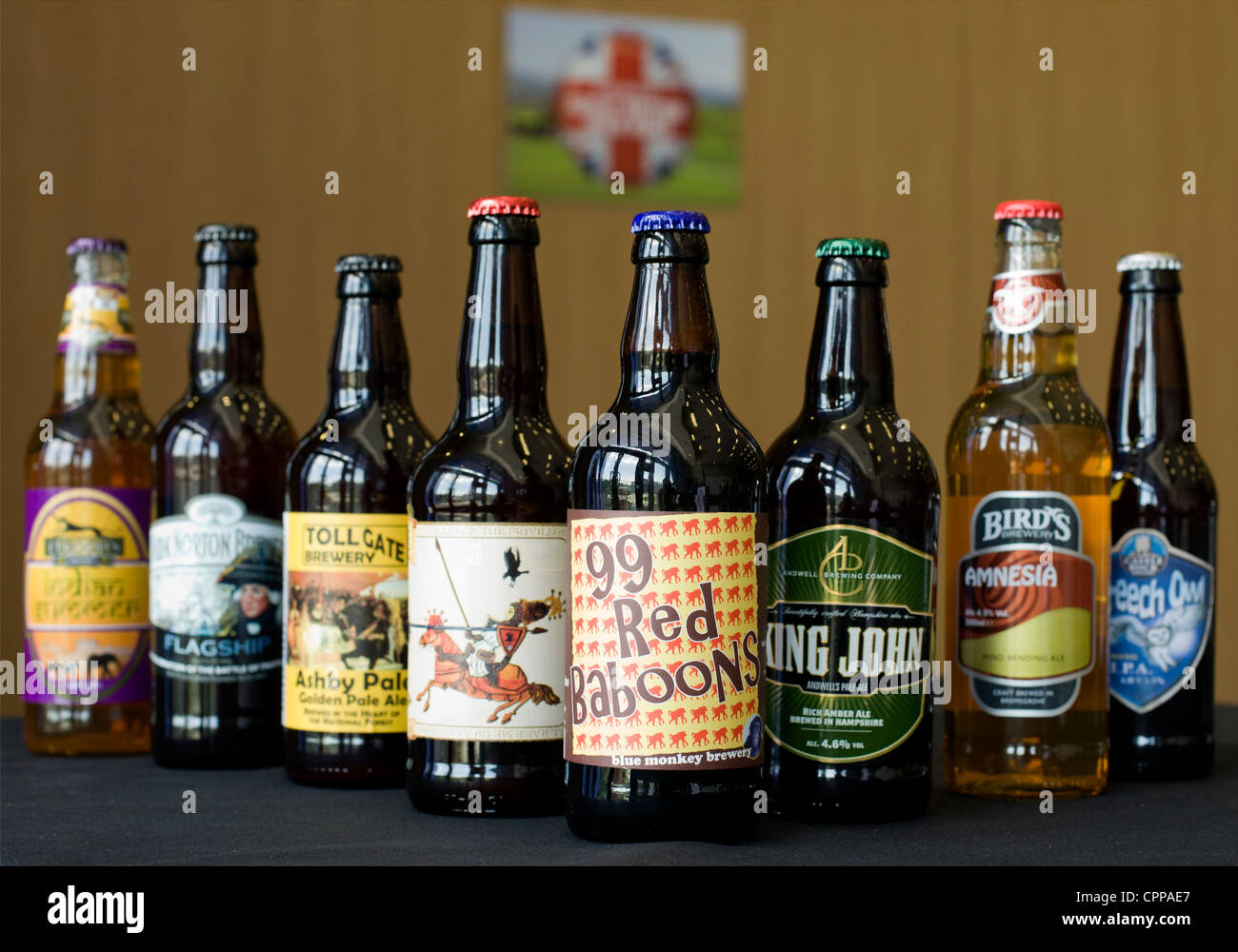 Bottles of Real Ale beer brewed in England. The breweries that make them give them distinctive names and colorful - Stock Image