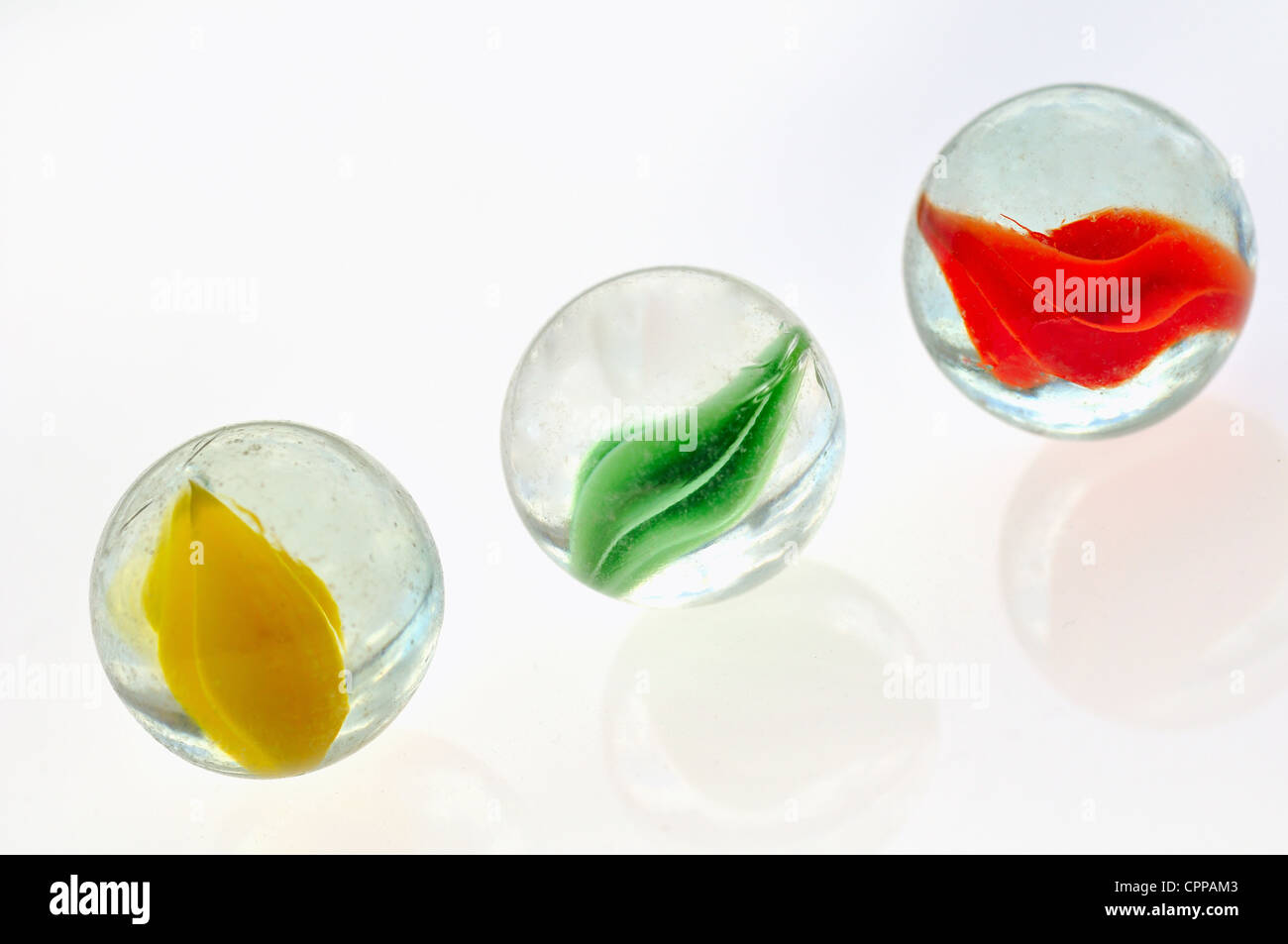 Three marbles on white background - Stock Image