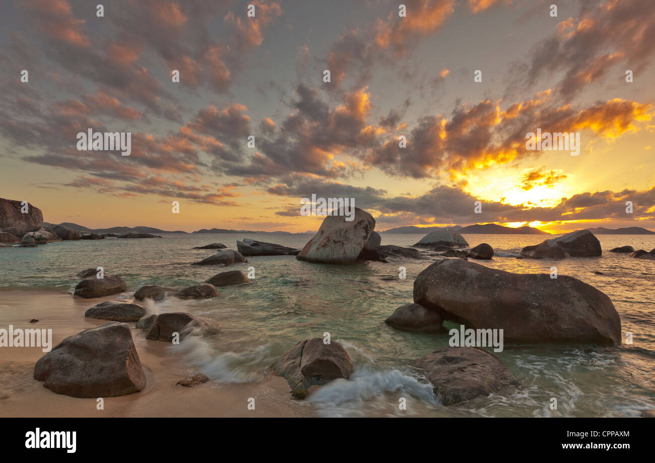 Virgin Gorda, British Virgin Islands, Caribbean Evening light on the beach with scattered boulders at The Baths - Stock Image