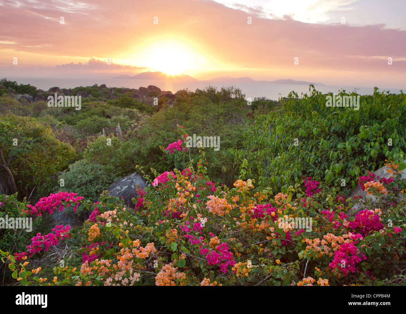 Virgin Gorda, British Virgin Islands, Caribbean: View of setting sun over distant islands in the Caribbean Sea - Stock Image