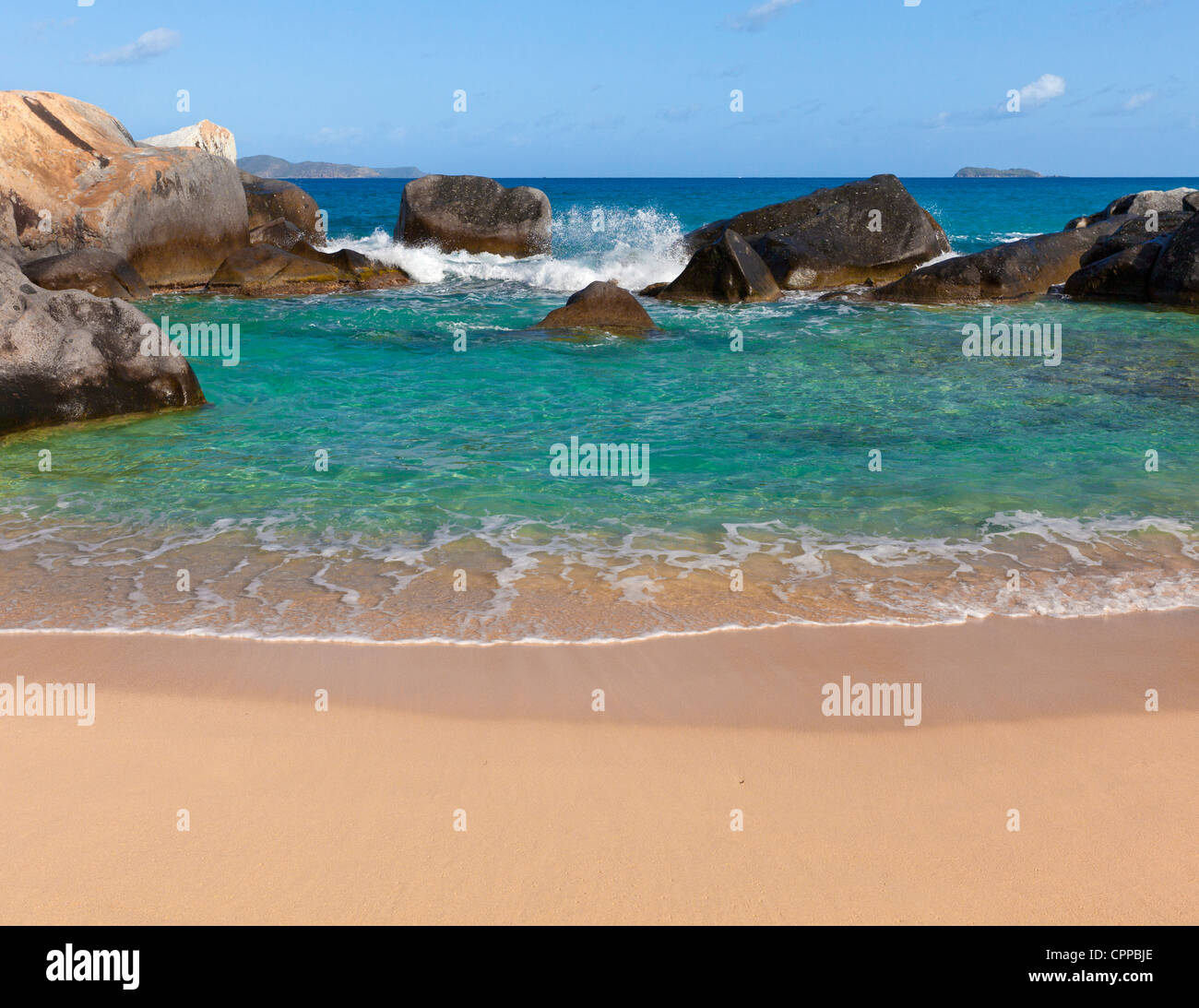Virgin Gorda, British Virgin Islands in the Caribbean Protected pool among the granite boulders on the beach known - Stock Image