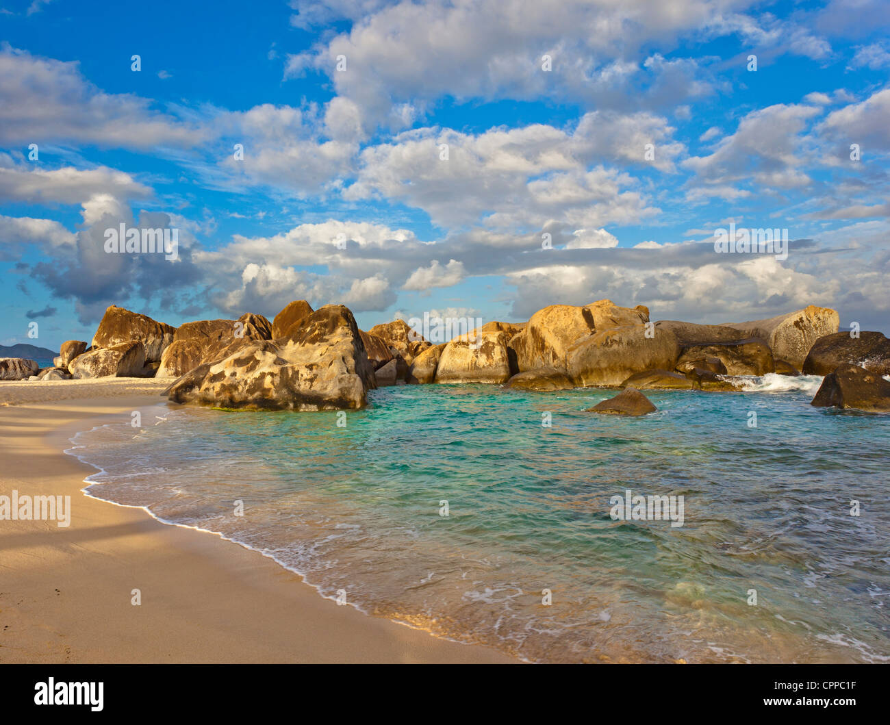Virgin Gorda, British Virgin Islands in the Caribbean Protected pool surrounded by granite boulders on the beach - Stock Image