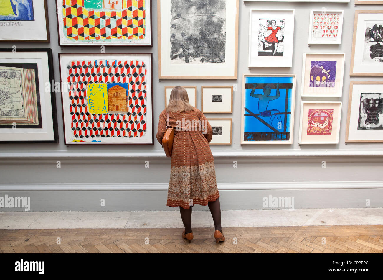28/05/2012. Royal Academy of Arts Summer Exhibition, London, UK. Image shows various art works being viewed in Gallery - Stock Image