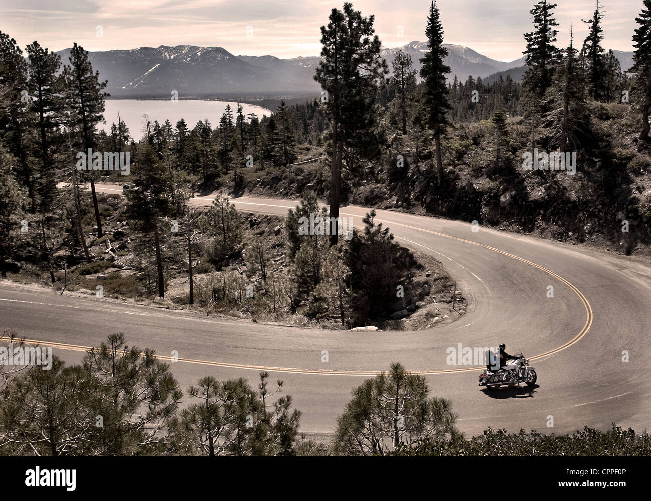 American motorcyclist riding down the mountain p Highway 89 at ...