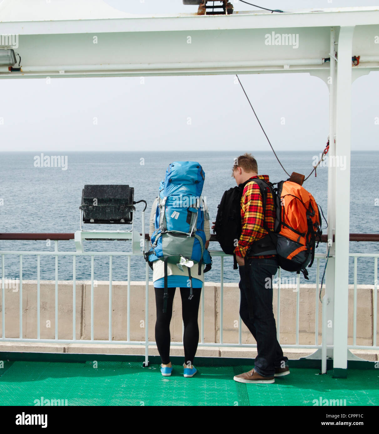 Young backpackers on inter island ferry in the Canary Islands, Spain - Stock Image