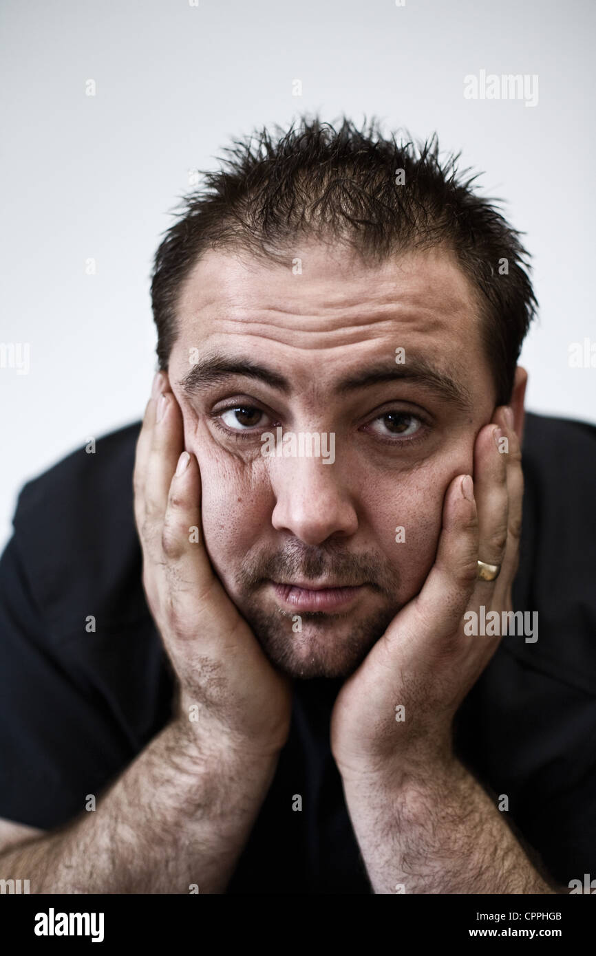 Portrait of a worried man - Stock Image