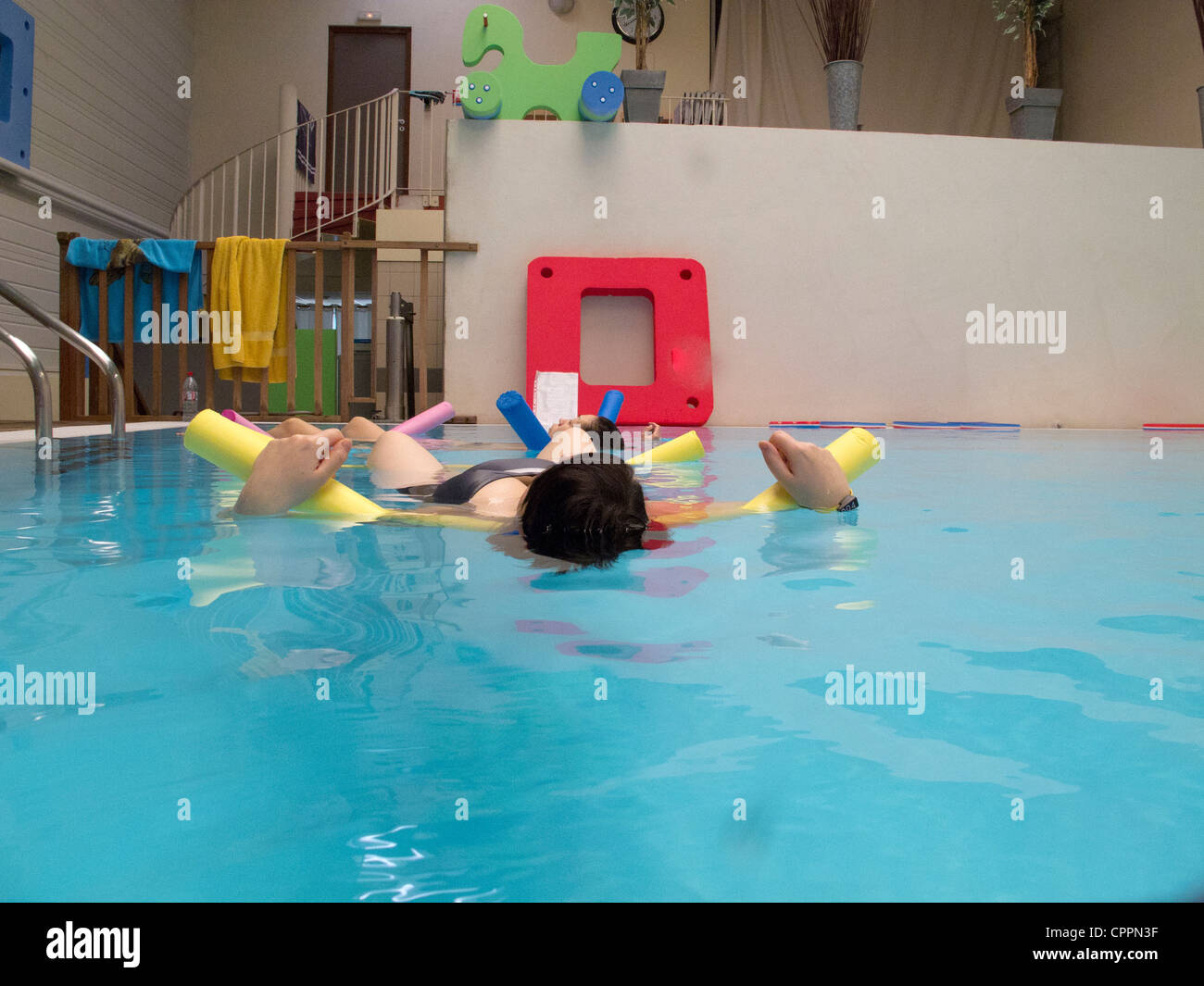 PREGNANT WO. EXERCISING IN WATER Stock Photo
