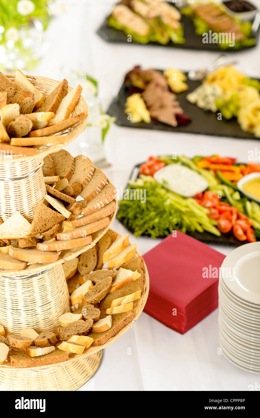 Bread selection catering buffet served food on white tablecloth - Stock Image