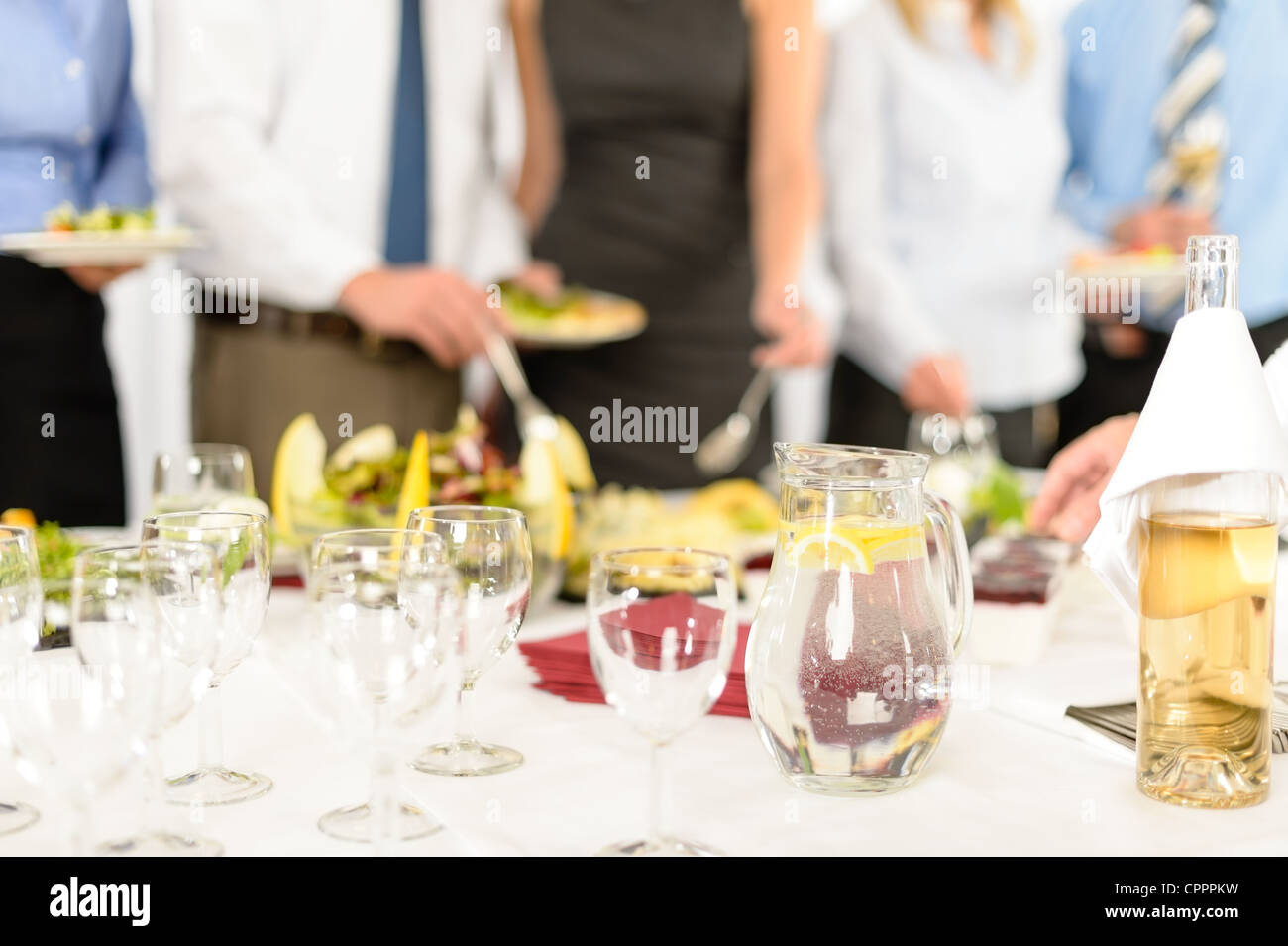 Company celebration close-up of glasses for drink catering in background - Stock Image