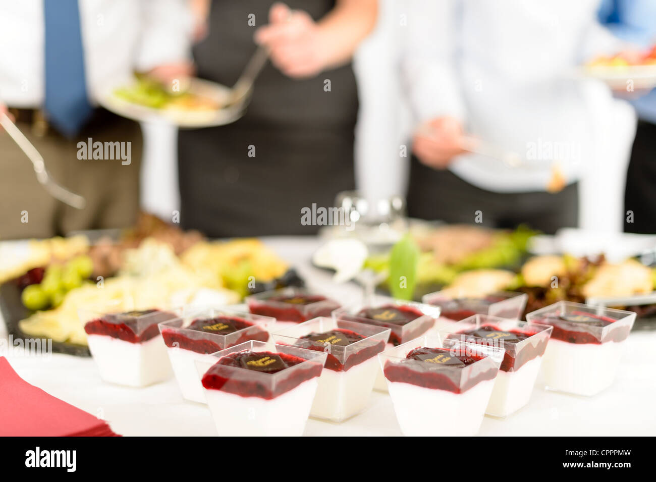 Appetizers mini desserts on catering buffet white tablecloth - Stock Image