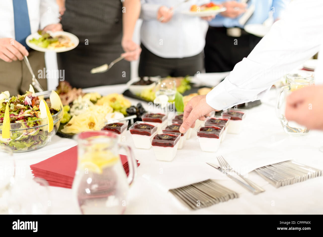 Appetizers mini desserts on catering buffet white tablecloth business event - Stock Image