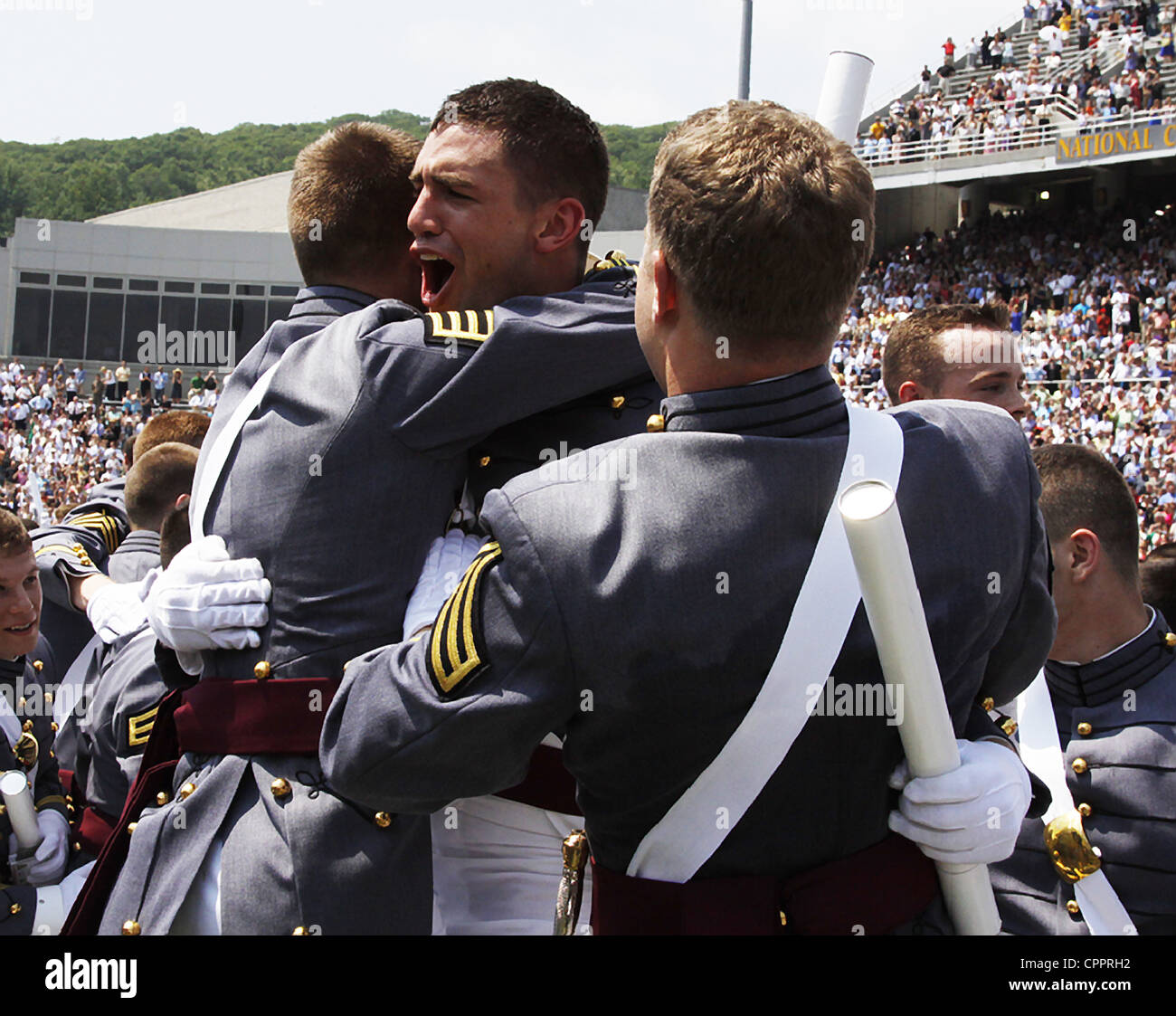 Graduating cadets from the US Military Academy class of 2012 hug following graduation ceremonies May 26, 2012 in - Stock Image