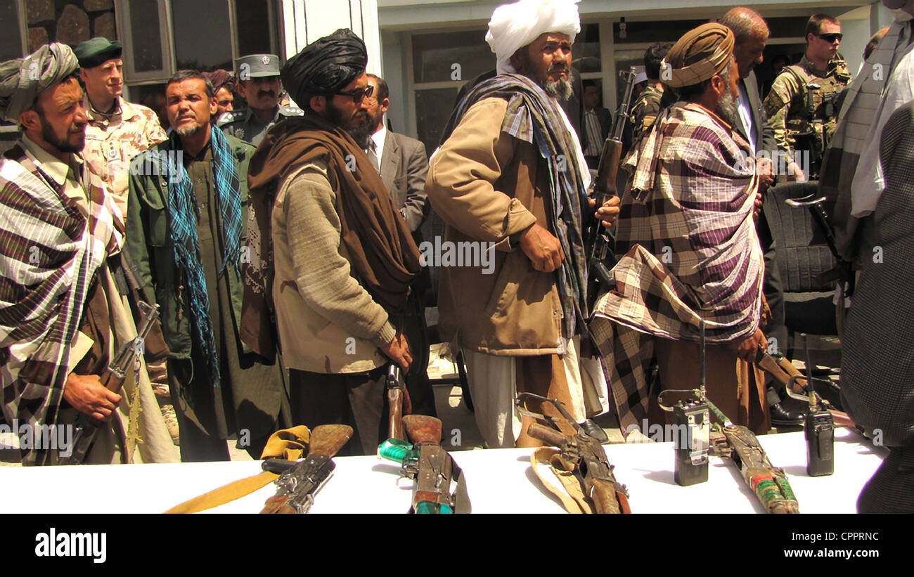 Former Taliban fighters line up to handover their Rifles to the Government of the Islamic Republic of Afghanistan - Stock Image