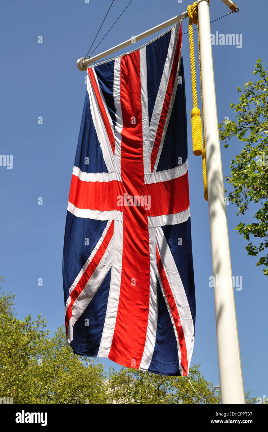 Union Jack Flag hanging vertically on a flagpole Stock Photo