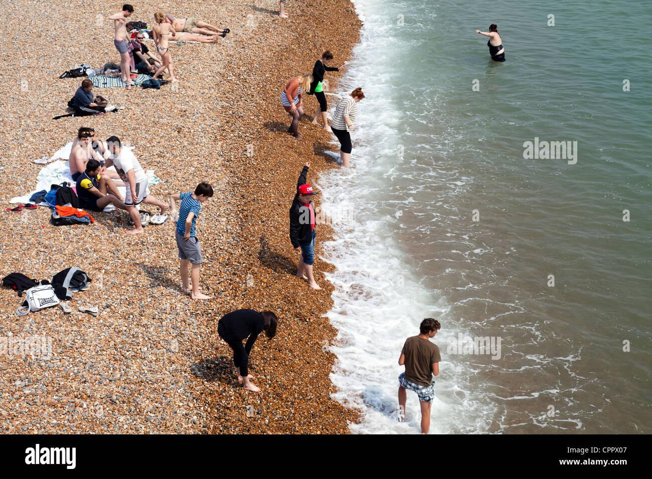 Brighton Beach Beachgoers in East Sussex - UK - Stock Image