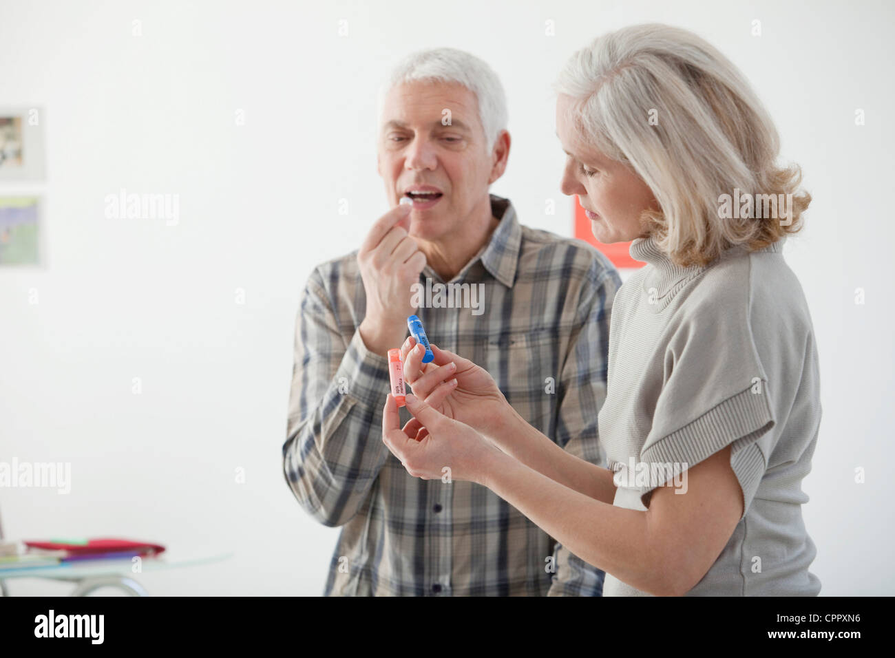 HOMEOPATHY, ELDERLY PERSON - Stock Image