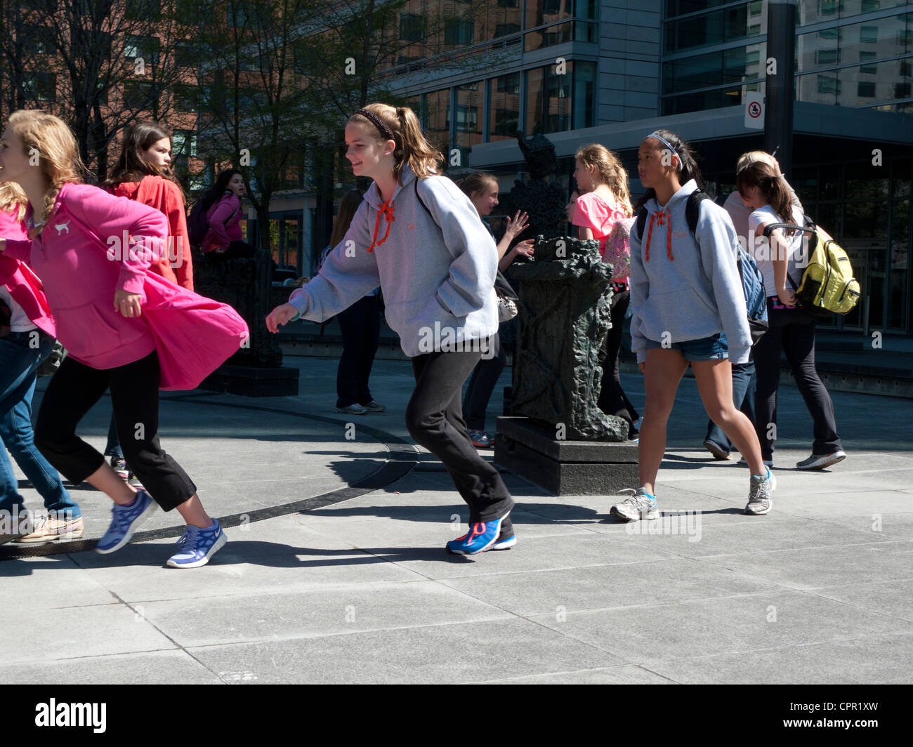 Girls running on school trip outing in Montreal, Quebec, Canada  KATHY DEWITT - Stock Image