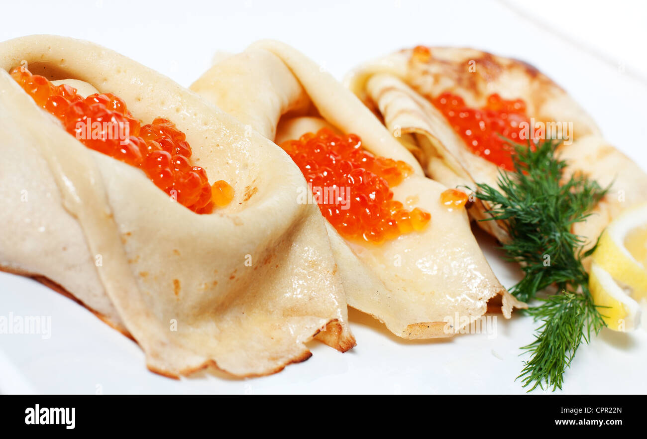 Hot pancakes with red caviar in the middle - Stock Image