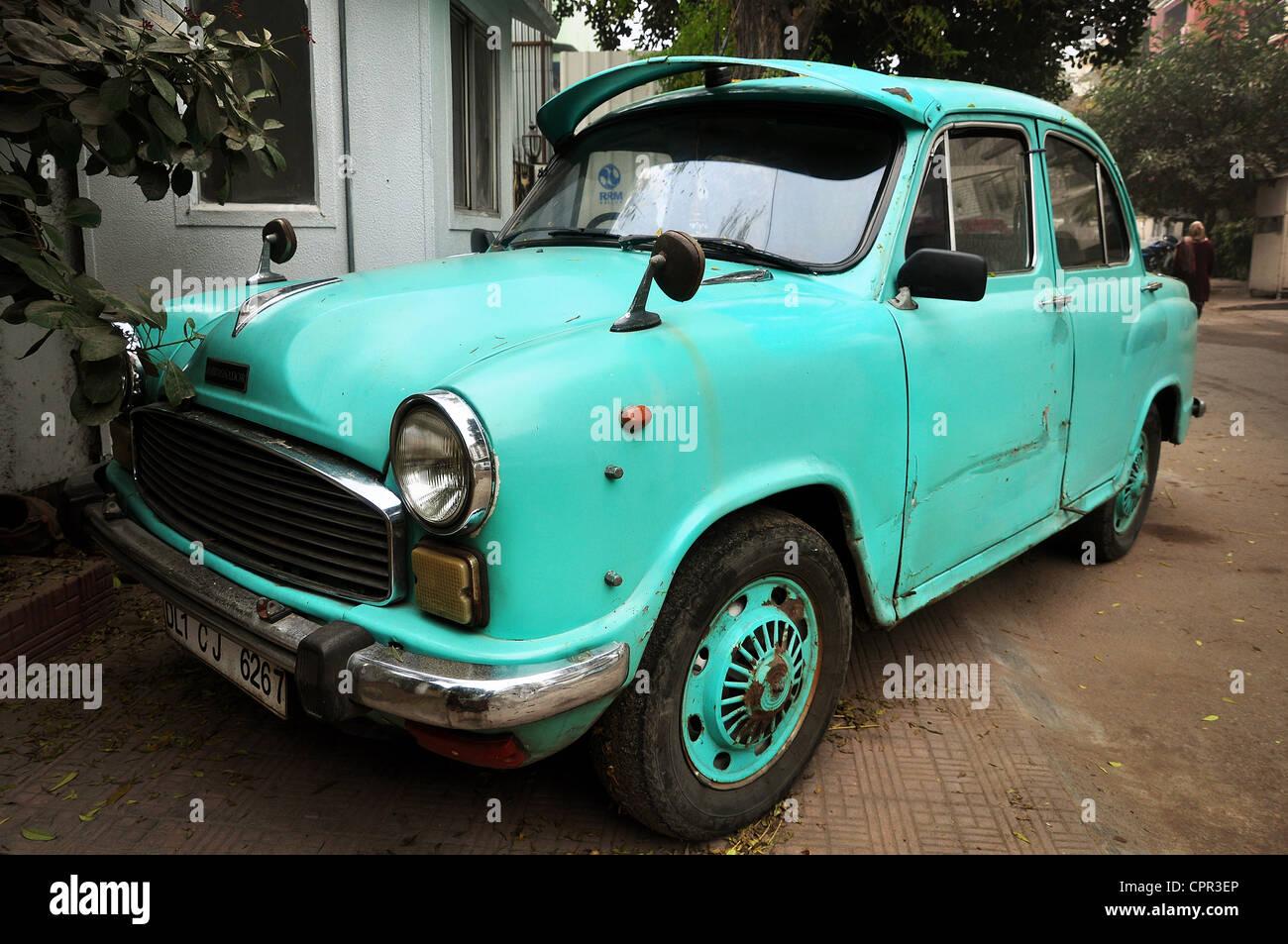 A teal Hindustan Ambassador car in New Delhi, India. - Stock Image