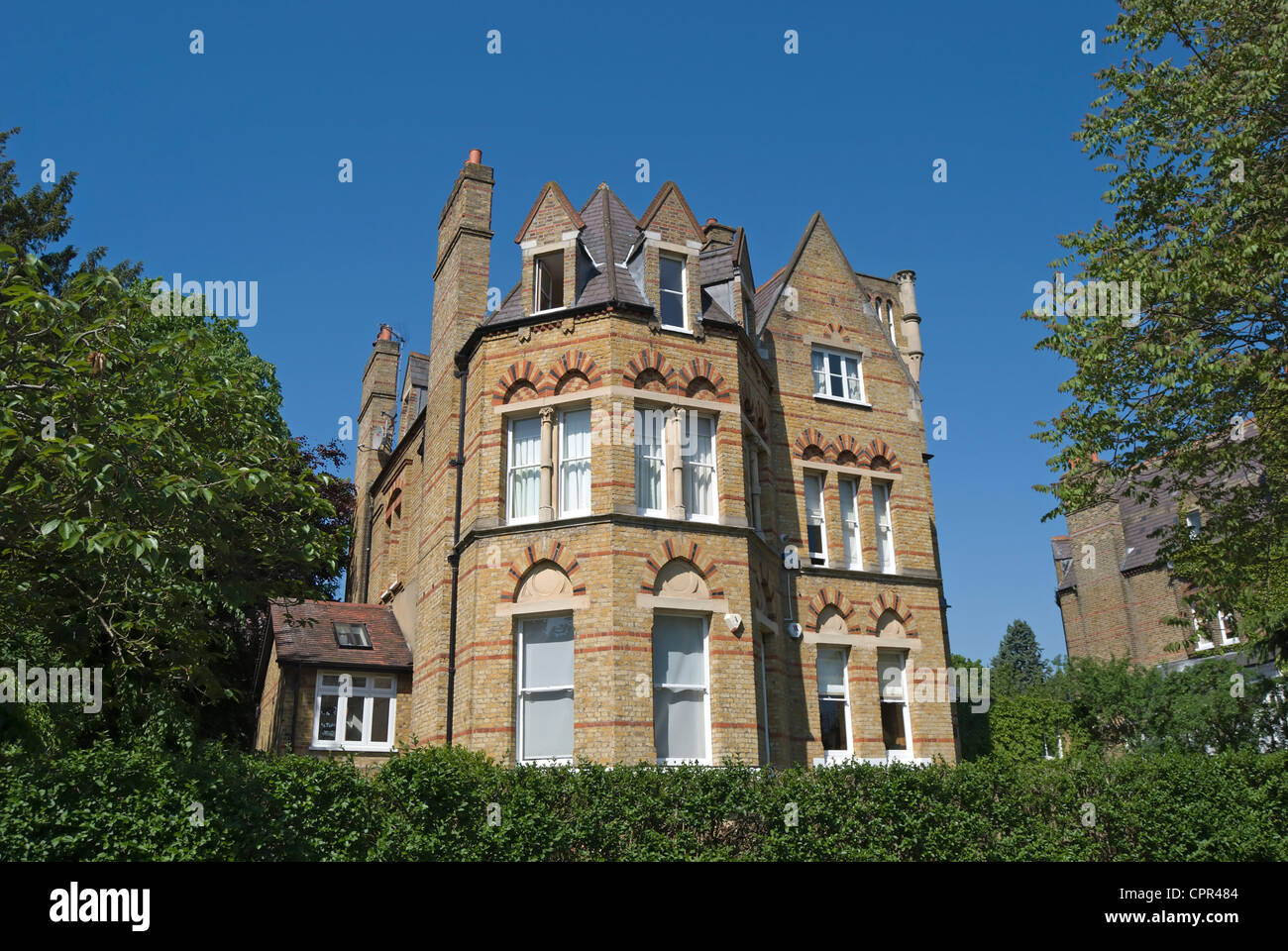 victorian detached house in gothic style, east twickenham, middlesex, england - Stock Image