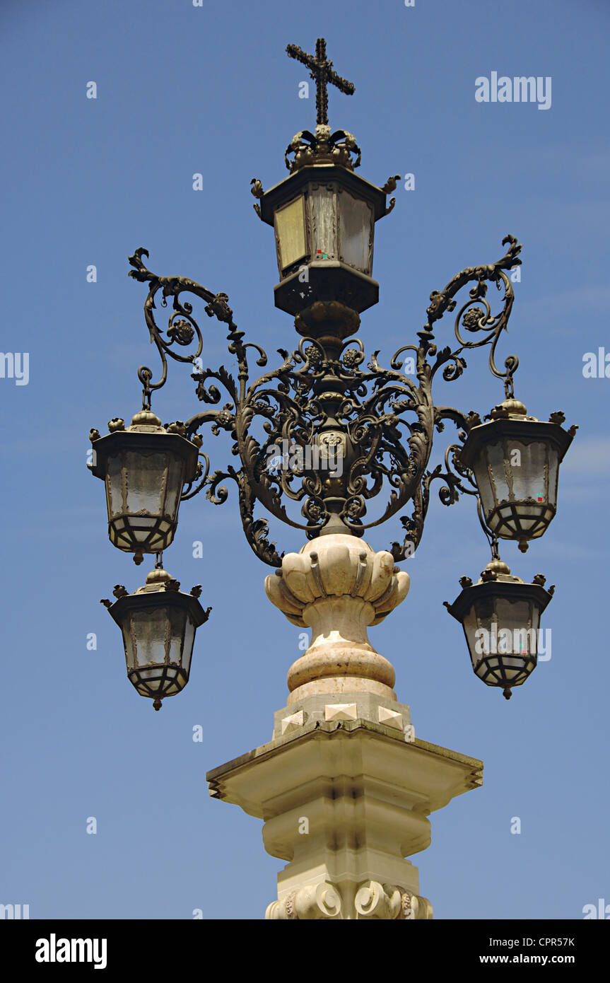 Detail of the source-streetlight by the sculptor Jose Lafita Diaz (1887-1945). Virgin of the Kings Square. - Stock Image