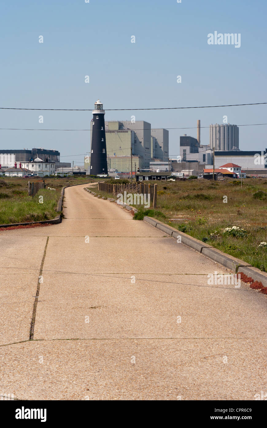 Dungeness Nuclear Power Station Kent Uk with The Old Lighthouse In The Foreground Seen Through Summer Heat Haze - Stock Image