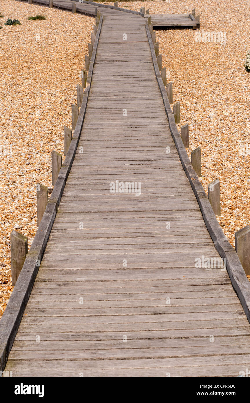 Dungeness Beach Kent UK Empty Deserted Wooden Boardwalk Path - Stock Image