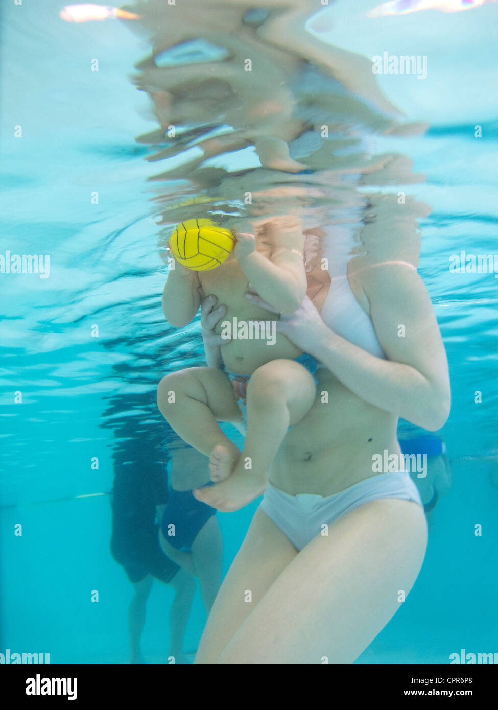 BABY SWIMMING Stock Photo