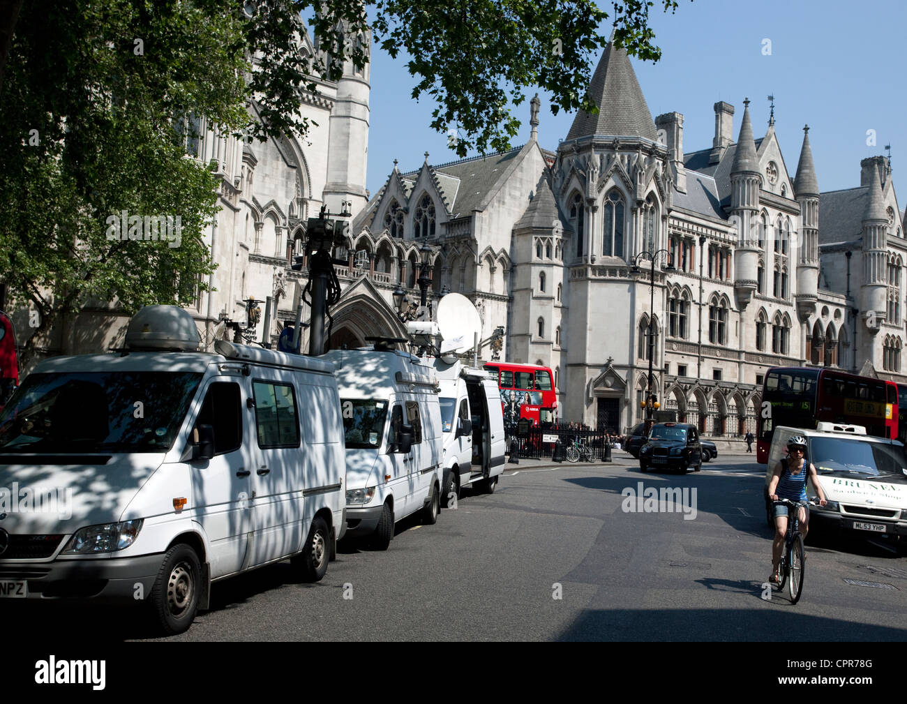 TV satellite vehicles outside Royal Courts of Justice, London as Blair appears at Leveson. Inquiry - Stock Image