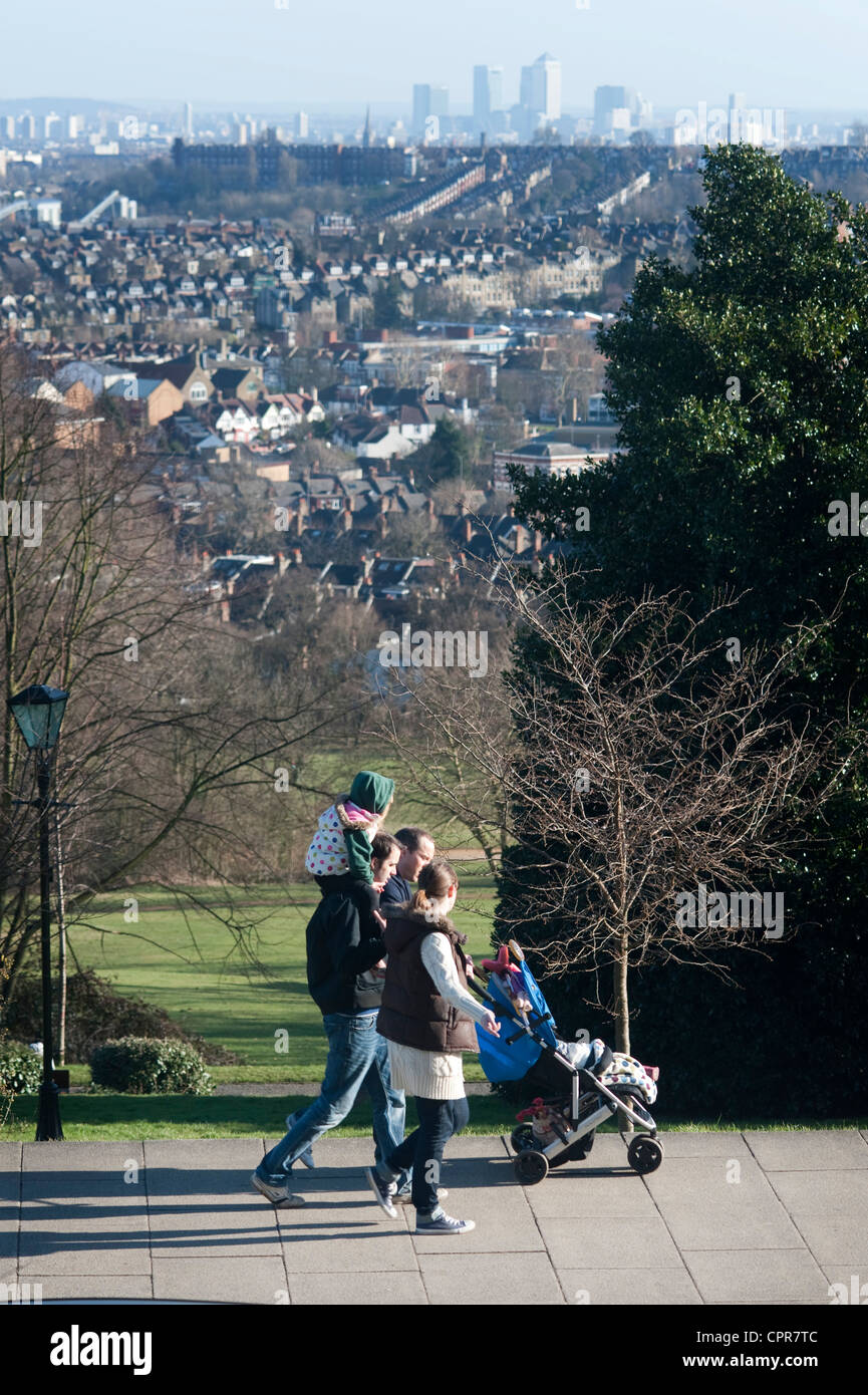 Family walking at Ally Pally with view of London in distance - Stock Image