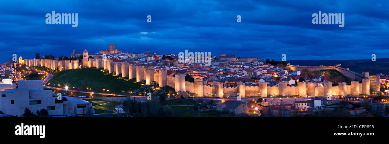 Aerial panoramic view of the illuminated city, wall fortress and towers rooks of Avila,Castilla-Leon, Spain - Stock Image