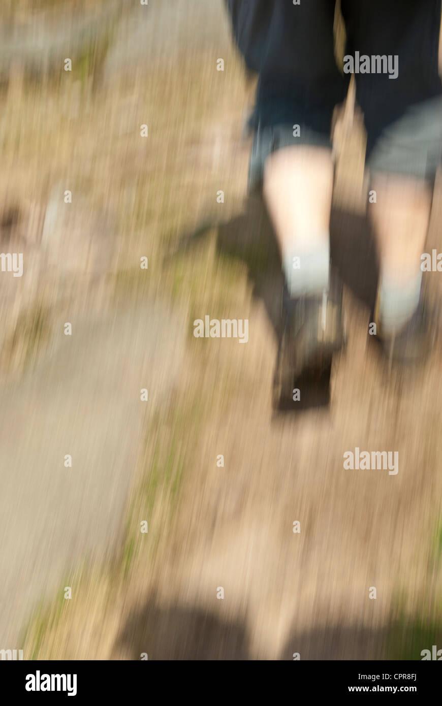 Man walking / hiking with motion blur - Stock Image