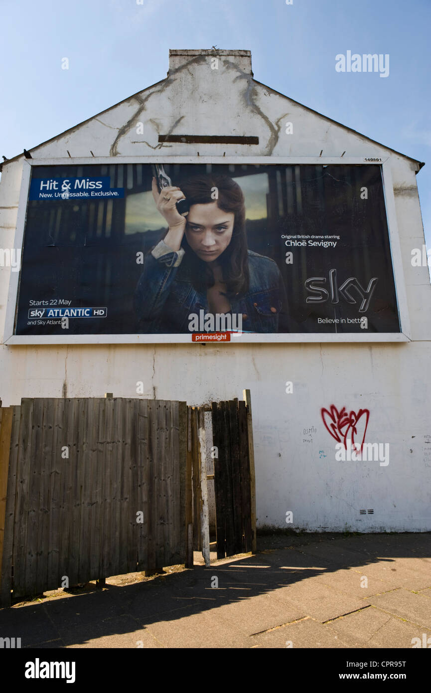 PRIMESIGHT advertising billboard on end wall of house for SKY ATLANTIC HD drama in Newport South Wales UK - Stock Image