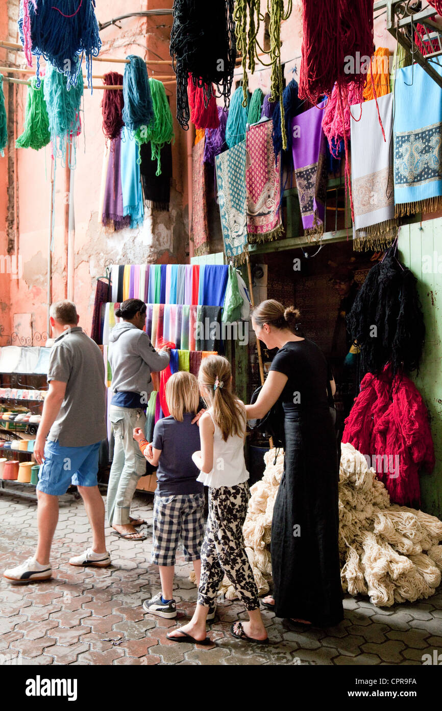 A tourist family shopping in the souk (market), Marrakech, Morocco Africa - Stock Image