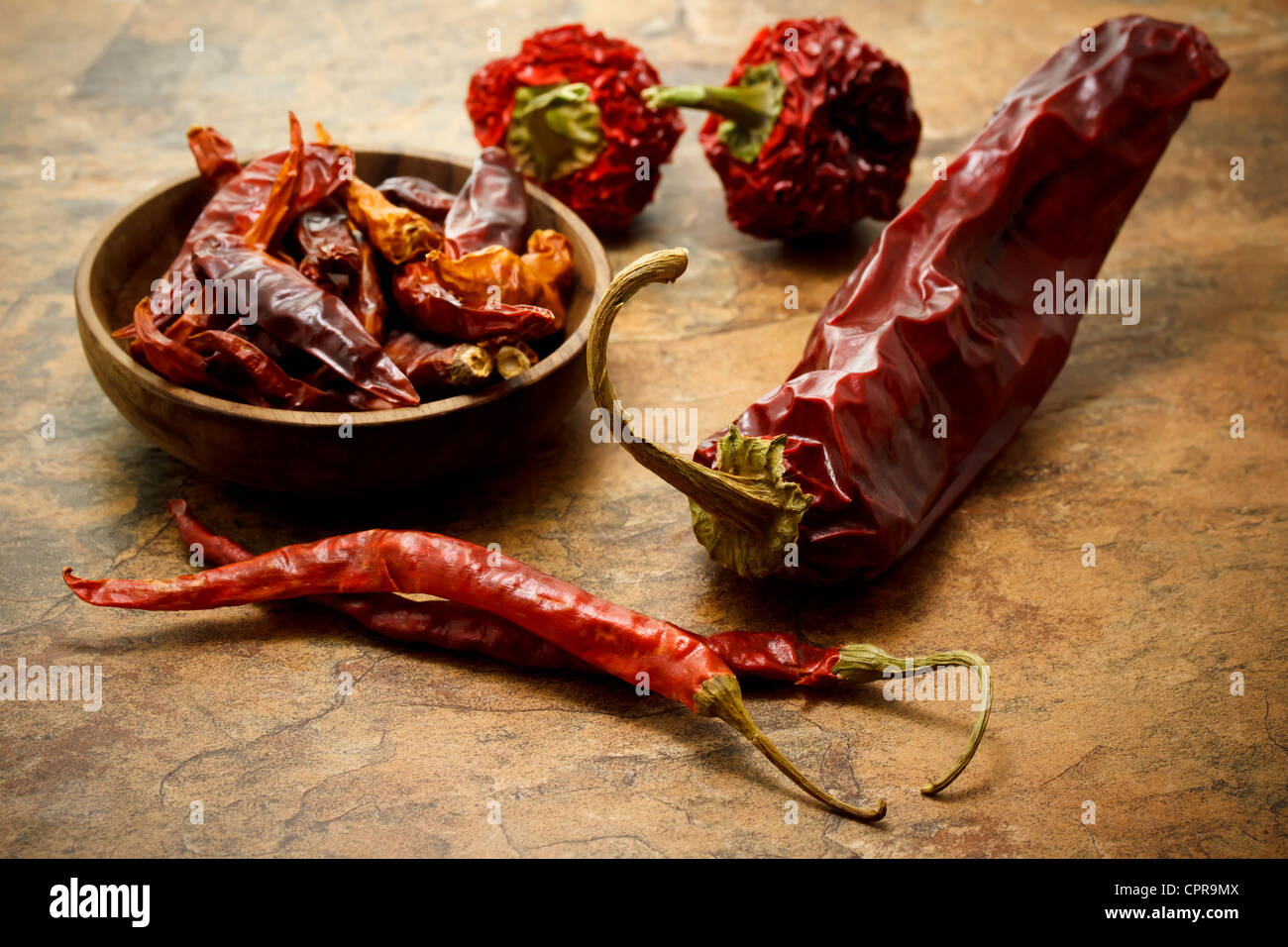 Assortment of dried chili peppers Stock Photo