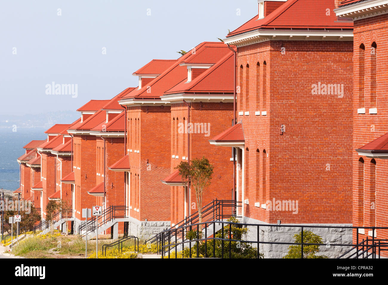 A row of brick buildings - Stock Image
