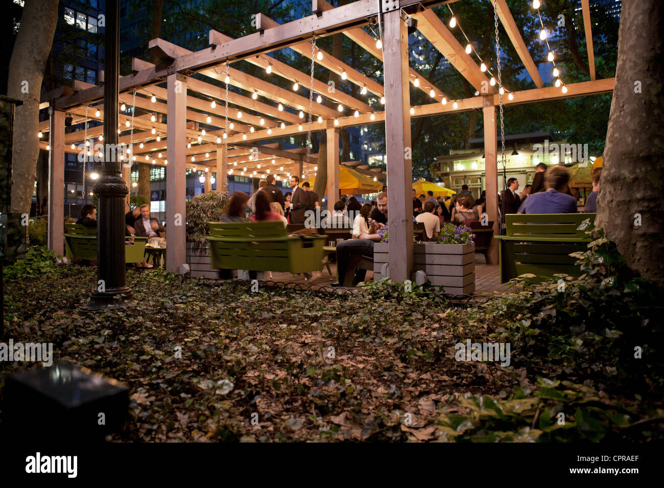 A wooden pergola lights up the Southwest Porch area of Bryant Park in New  York City. - A Wooden Pergola Lights Up The Southwest Porch Area Of Bryant Park
