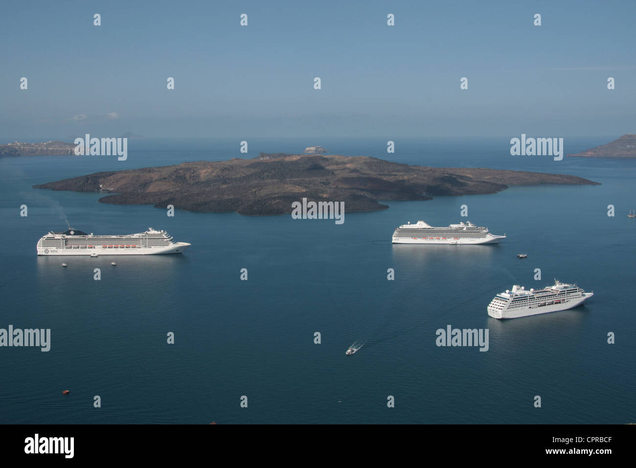Cruise ships anchored in the caldera at Santorini, Greece - Stock Image