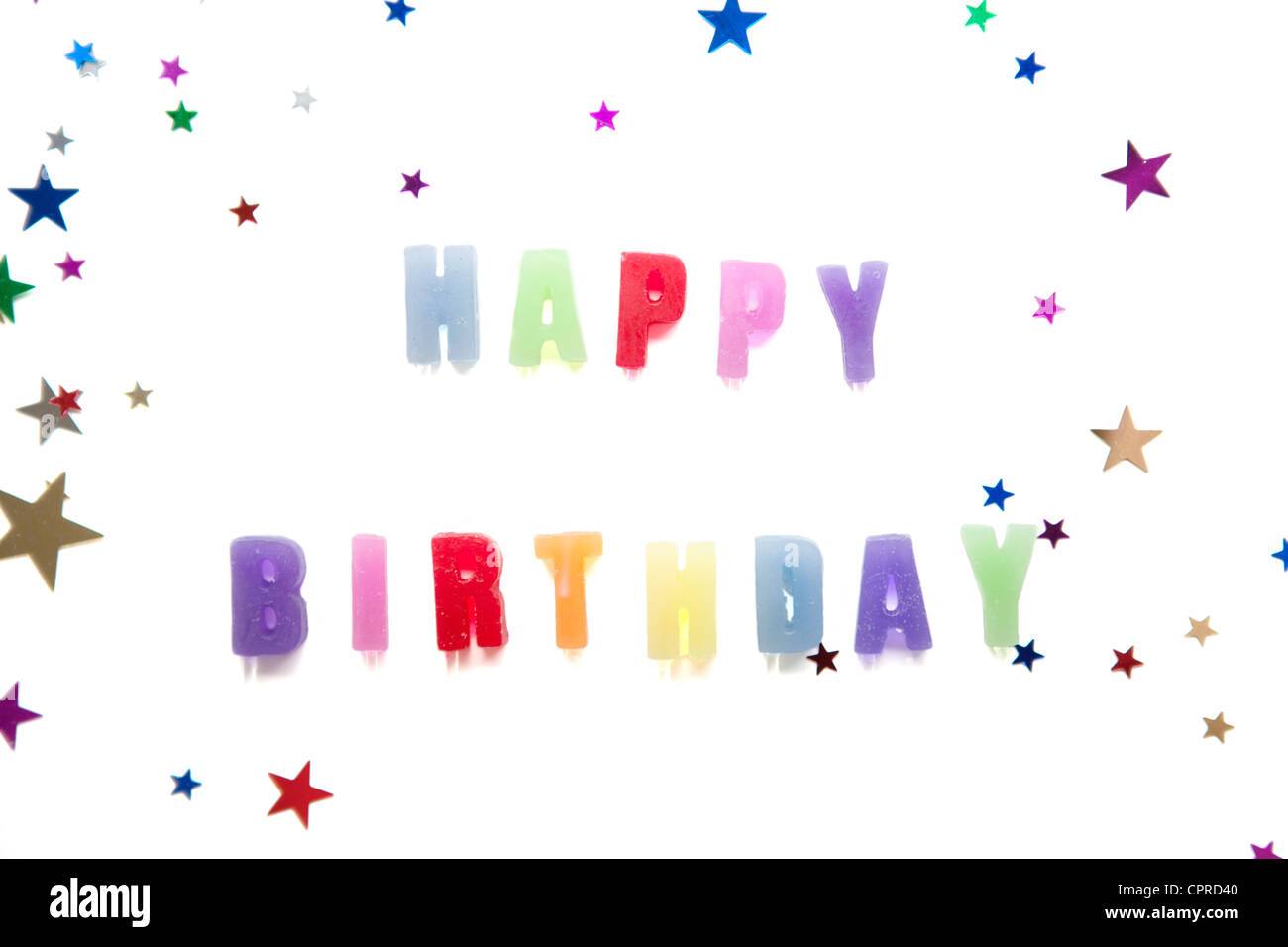 the words happy birthday using candles set on a white background