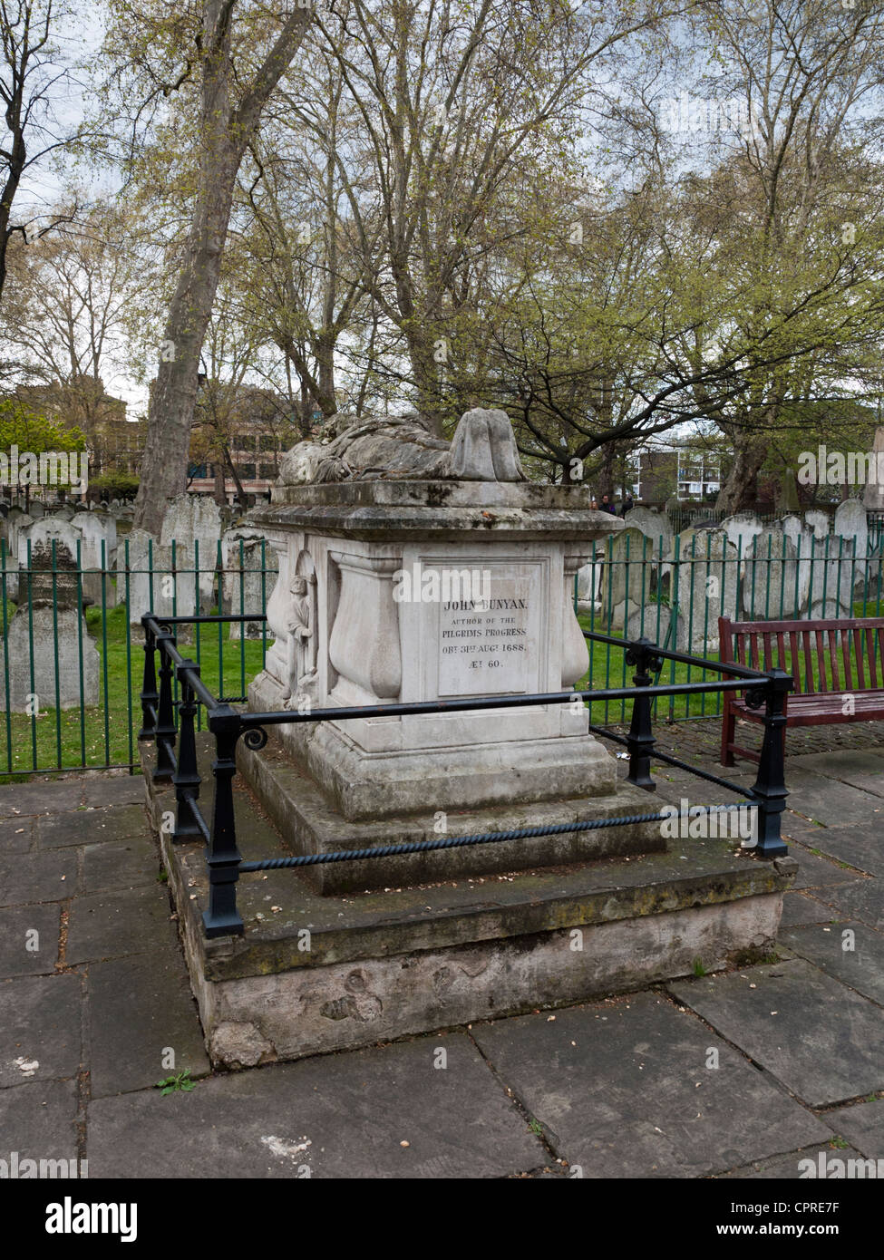 The grave of the English Christian writer and preacher known for his book The Pilgrim's Progress - Stock Image