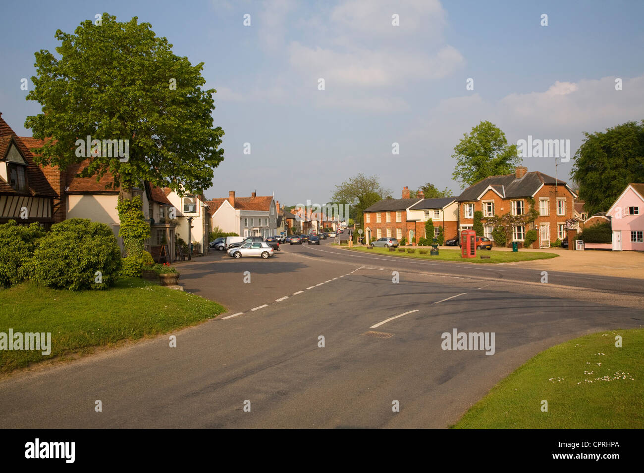 Road junction village houses Cavendish, Suffolk, England - Stock Image