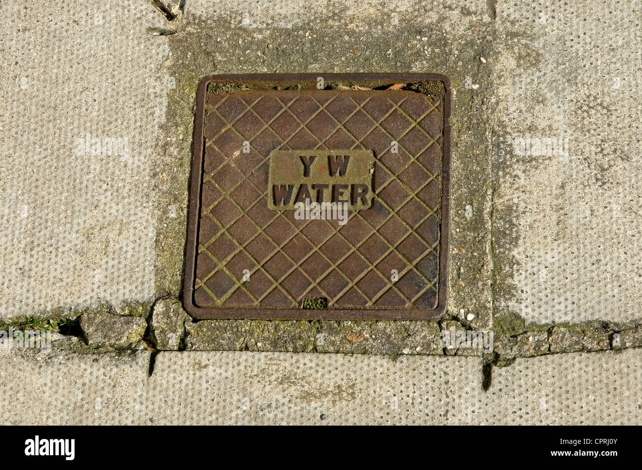 Water main access point set in the pavement North Yorkshire England UK United Kingdom GB Great Britain - Stock Image